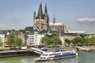 Кельнский кафедральный собор на фоне Рейна